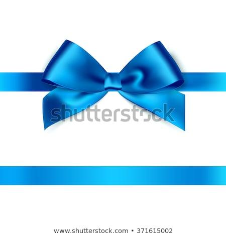 Stock photo: Shiny blue satin ribbon on white background