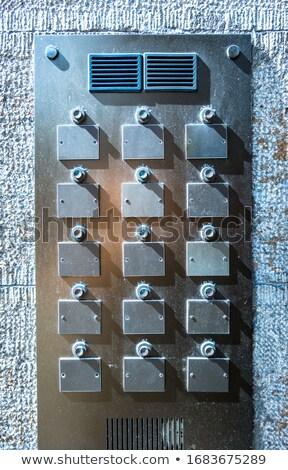 Old weathered intercom button panel Stock photo © stevanovicigor