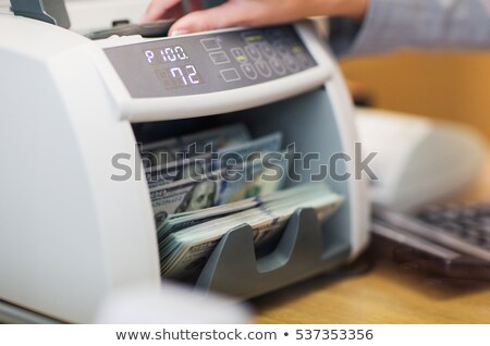 dollars in electronic money counter at bank office Stock photo © dolgachov