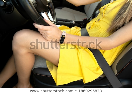 Long woman's legs on a steering wheel of a car Stock photo © Nobilior