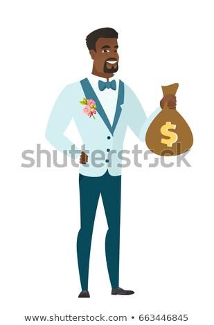 Fiatal vőlegény mutat pénz táska dollárjel Stock fotó © RAStudio