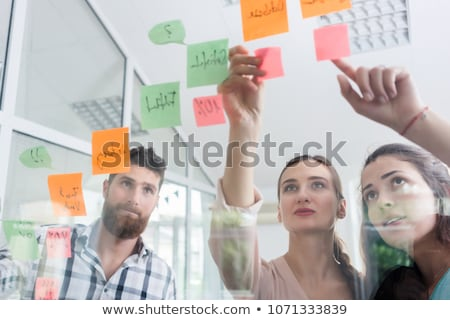 reliable young workers posting reminders in a modern co-working  Stock photo © Kzenon