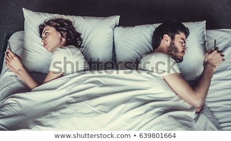 Couple Bed Girl Phone Stock photo © lenm
