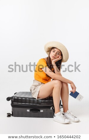 Business woman sitting with luggage Stock photo © IS2