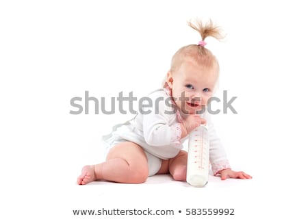 cute happy baby girl in white shirt hold bottle stock photo © Traimak