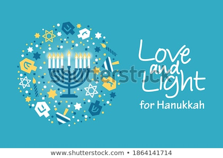 Happy Hanukkah with bright light on candles Stock photo © bluering