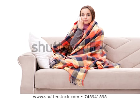 Teenager suffering from cold sitting on coach Stock photo © Elnur