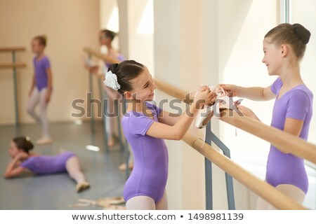 Ballet dancers talking at barre Stock photo © IS2