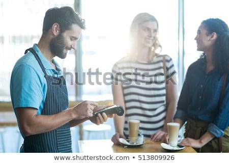 Sorridere cameriere Cup freddo caffè Foto d'archivio © wavebreak_media