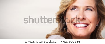 face of happy smiling middle aged woman Stock photo © dolgachov