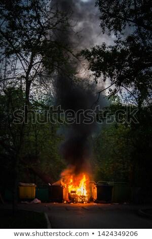 Ognia pojemnik na śmieci kosz na śmieci domu dymu płomień Zdjęcia stock © MaryValery
