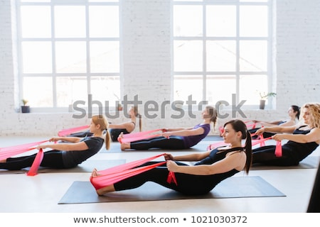 Stock photo: pilates yoga resistance band red rubber gym woman