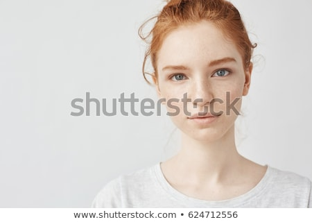 Close-up portrait of beautiful red-haired girl. Stock photo © Massonforstock
