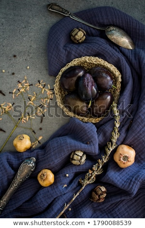 Plums on blue plate on table Stock photo © dash