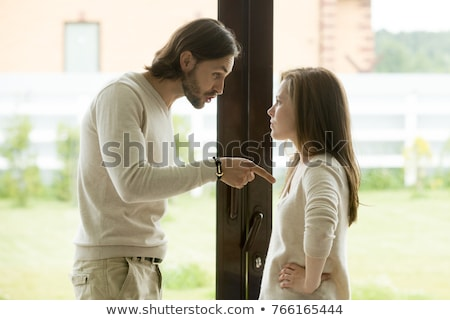 Angry young woman having an argument with her boyfriend Stock photo © deandrobot