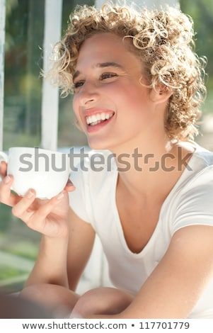 attractive woman with short curly hair and drink stock photo © traimak
