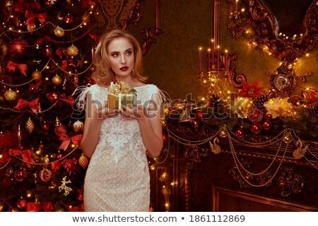 portrait of a blond elegant lady in a luxurious golden apartme stock photo © majdansky