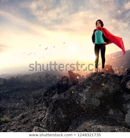 Successful businesswoman acts like a super hero on a mountain. Concept of determination and success Stock photo © alphaspirit