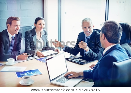 Stock photo: Businesspeople sitting  in conference room during meeting at off