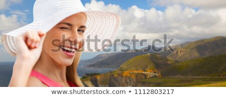 beautiful woman in sun hat over big sur coast Stock photo © dolgachov
