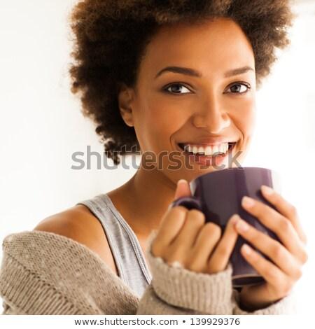 画像 女性 20歳代 巻き毛 笑みを浮かべて ストックフォト © deandrobot