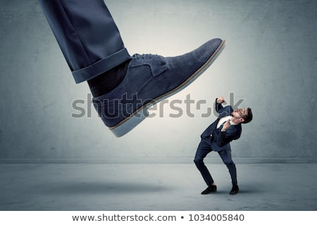 Employee getting trampled by big shoe Stock photo © ra2studio