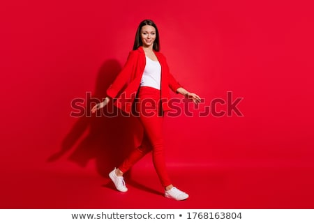 full length photo of happy businesswoman wearing office suit smi stock photo © deandrobot