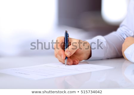 Man filling out form Stock photo © jossdiim