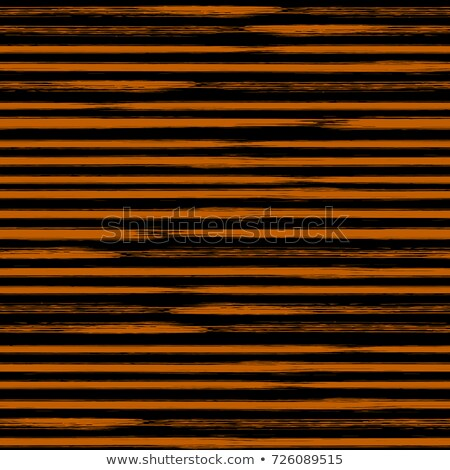 abstract black and orange stripes seamless repeating pattern vector illustration stock photo © jeff_hobrath