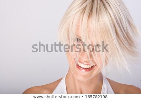 Charismatische jonge blond vrouw lachend camera Stockfoto © Giulio_Fornasar