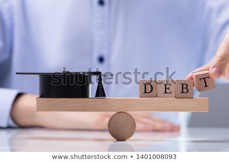 Debt Word And Graduation Hat Balancing On Seesaw Stock photo © AndreyPopov