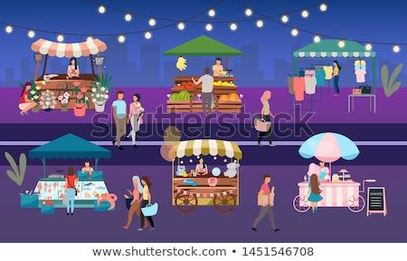 Comida de rua vendedor frutos do mar noite mercado Foto stock © galitskaya