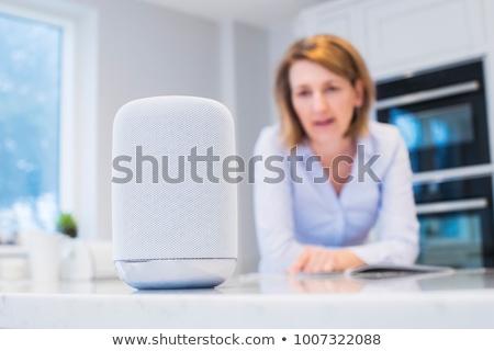 Nő hallgat zene okos hangszóró közelkép Stock fotó © AndreyPopov