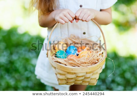 ストックフォト: Close Up Of Colored Easter Eggs In Basket