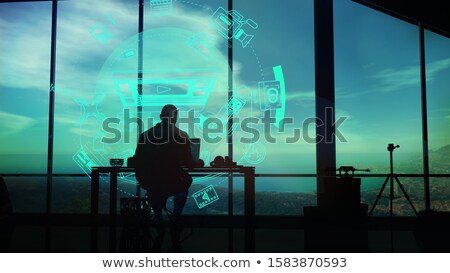 Videographer at the desk on a background of infographics. Stock photo © ConceptCafe
