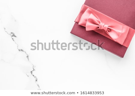 Coral gift box with silk bow on marble background, girl baby sho Stock photo © Anneleven