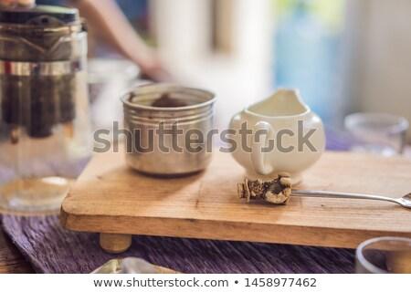 Tener cuchara taza té tetera azúcar Foto stock © galitskaya