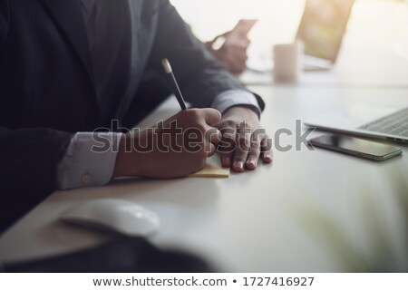 Business Executives Taking Notes During A Meeting Stock photo © AndreyPopov
