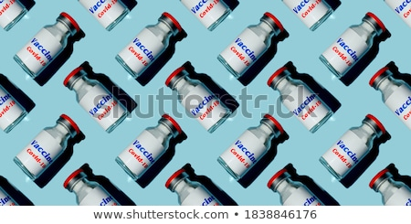 Disposable syringes of red and blue vaccine with shadows. Stock photo © artjazz