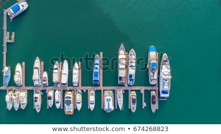 Pier speedboat. A marina lot. This is usually the most popular tourist attractions on the beach.Yach Stock photo © galitskaya