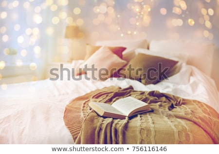 coziness, comfort, interior and holidays concept - cozy bedroom with bed. Stock photo © ruslanshramko