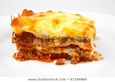 Közelkép lasagna szelet tányér étel étterem Stock fotó © elly_l
