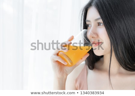 healthy fresh orange drink for beautiful woman stock photo © darrinhenry