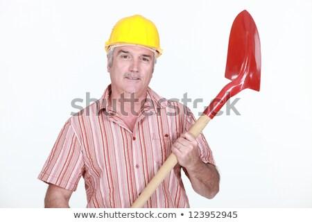 mature bricklayer holding shovel against studio background Stock photo © photography33