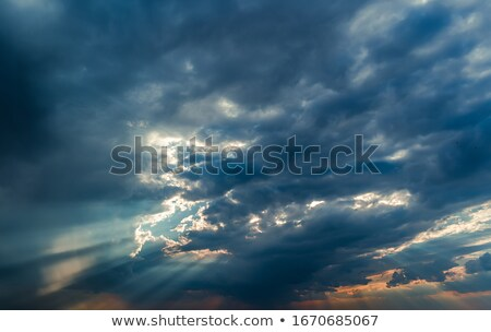 Sunrays through cumulonimbus clouds Stock photo © Anna_Om