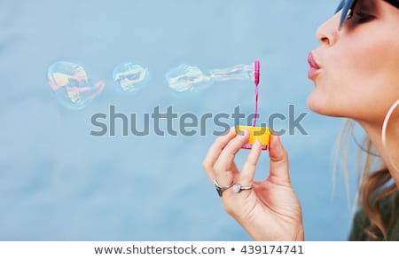 blonde blowing soap bubble stock photo © ssuaphoto