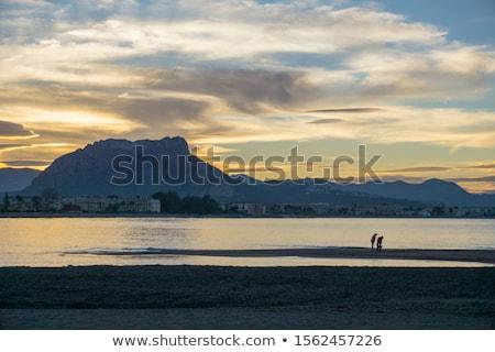 Plaj gün batımı İspanya akdeniz manzara okyanus Stok fotoğraf © lunamarina