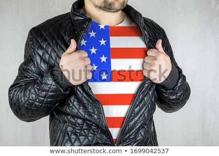 Man stretching jacket to reveal shirt with USA flag Stock photo © stevanovicigor