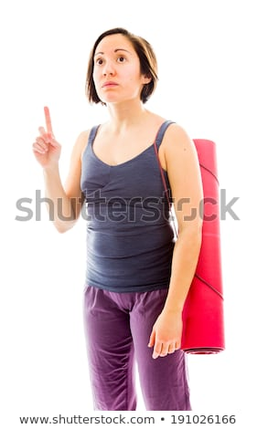 Young woman carrying exercise mat pointing her finger up Stock photo © bmonteny
