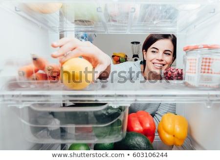 Kadın buzdolabı kafkas genç kadın seksi kırmızı Stok fotoğraf © iofoto